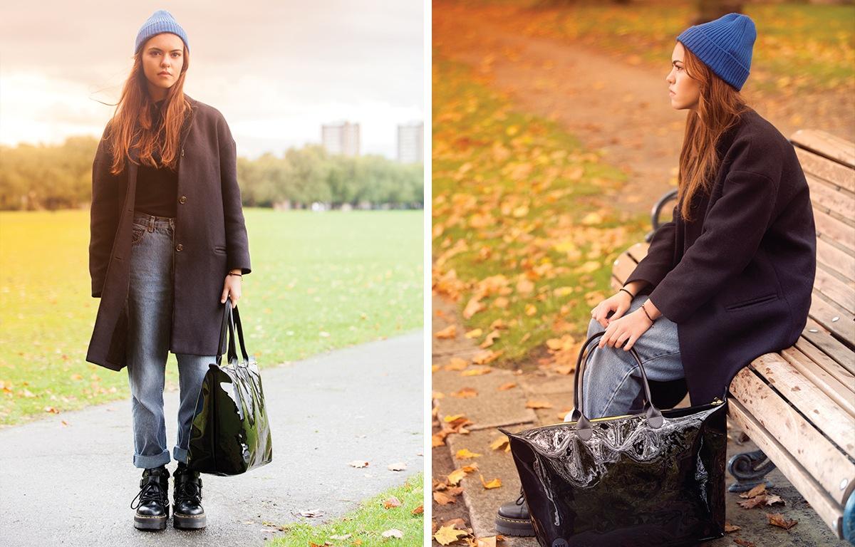 meisje met zwarte weekendtas in een park